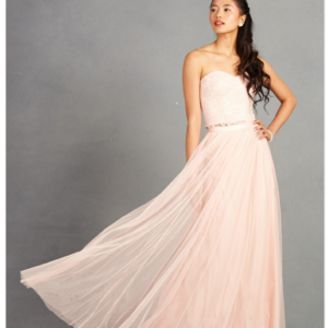 Strapless crop top in a beautiful floral lace, over a raw-cut tulle skirt. Sold as a two-piece.